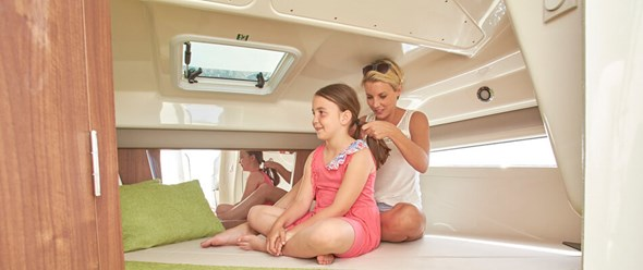 Large front berth with large hull windows and privacy curtains